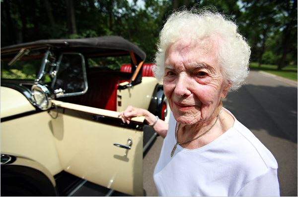 Margaret Dunning of Plymouth, Mich., with her 1930 Packard 740 roadster.